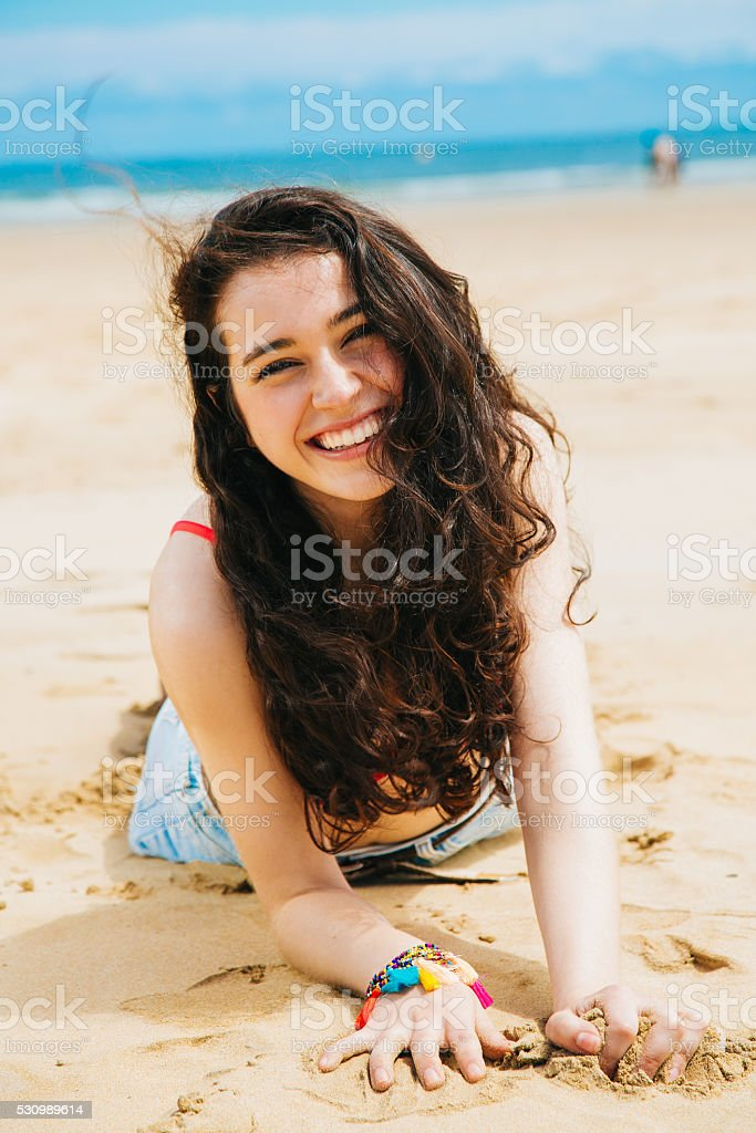 Laughing girl on the beach stock photo