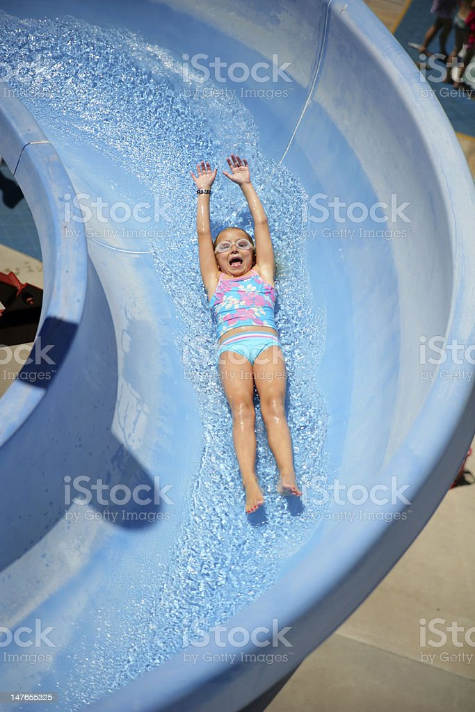 Laughing girl on Waterslide stock photo
