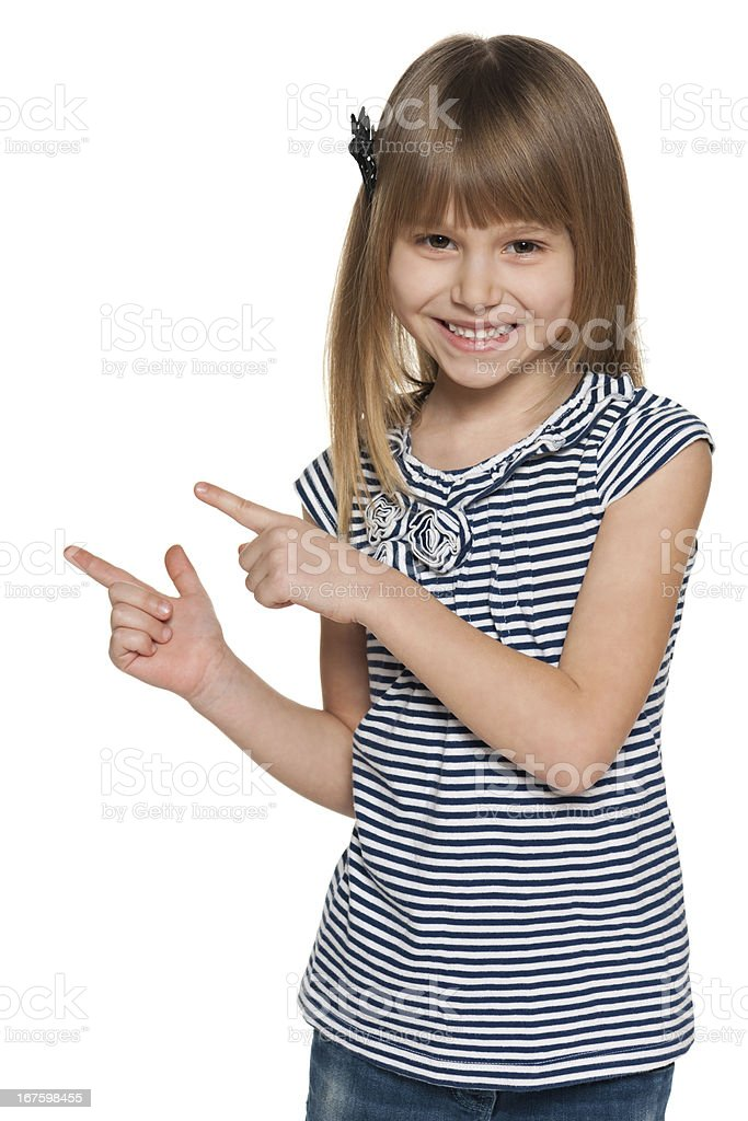 Laughing girl shows her fingers to the side stock photo