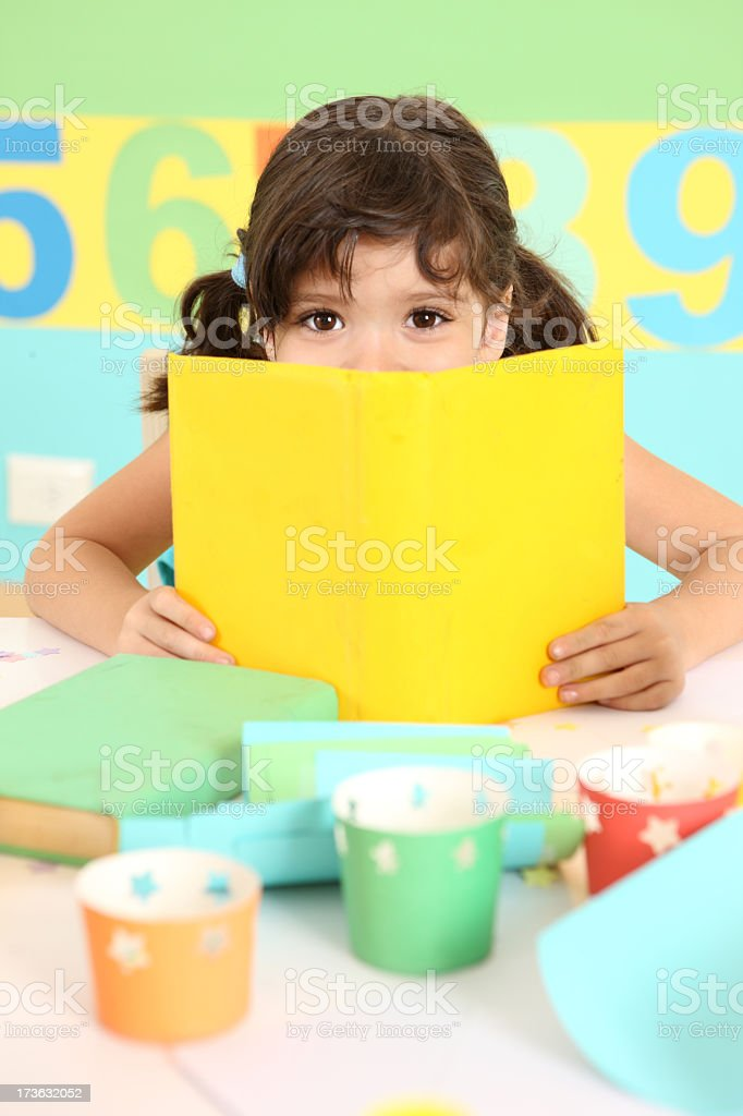 Laughing girl with book royalty-free stock photo