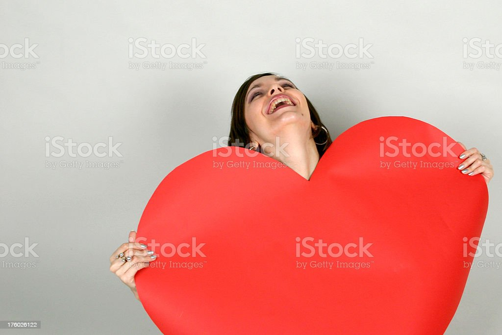 laughing girl with red heart stock photo