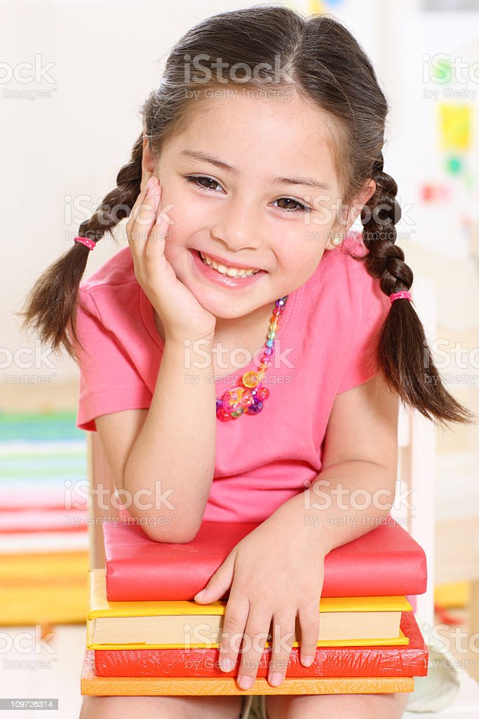 laughing girl  with stack of books royalty-free stock photo