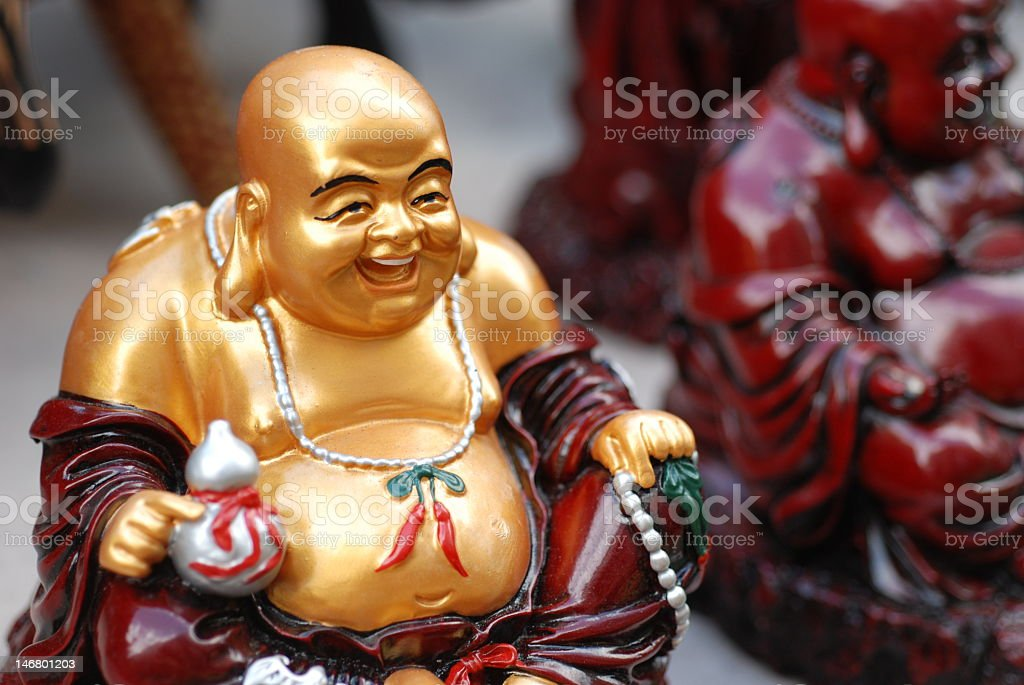 Laughing Golden Buddha stock photo