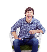 Laughing guy in armchair