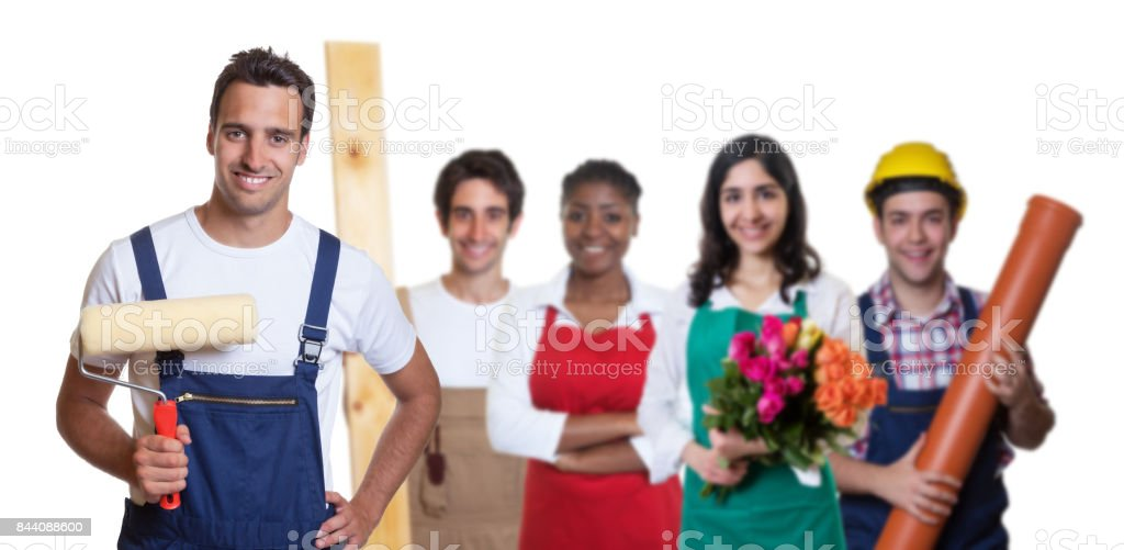 Laughing hispanic painter with group of other international apprentices stock photo