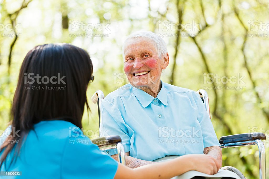 Laughing Lady in Wheelchair royalty-free stock photo