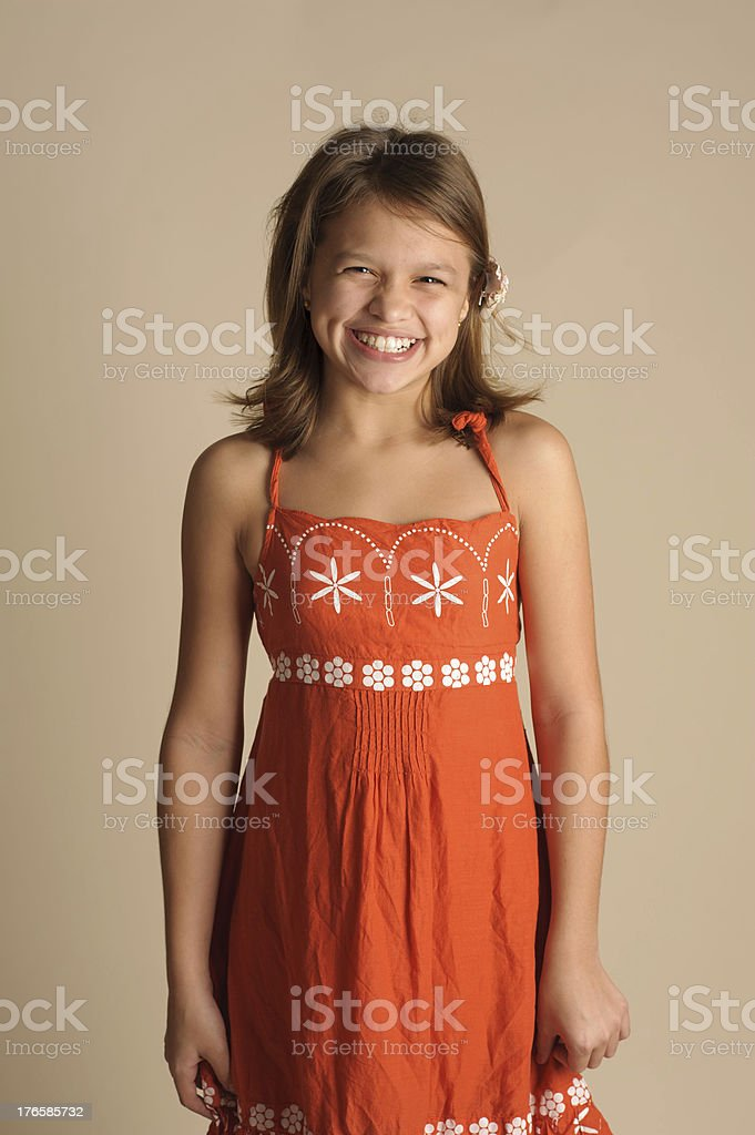 Laughing Little Girl With Dimples Wearing Orange Sun Dress royalty-free stock photo