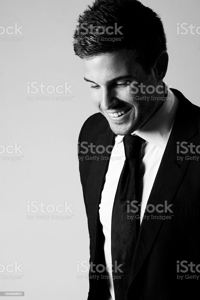 Laughing Man in a black suit royalty-free stock photo
