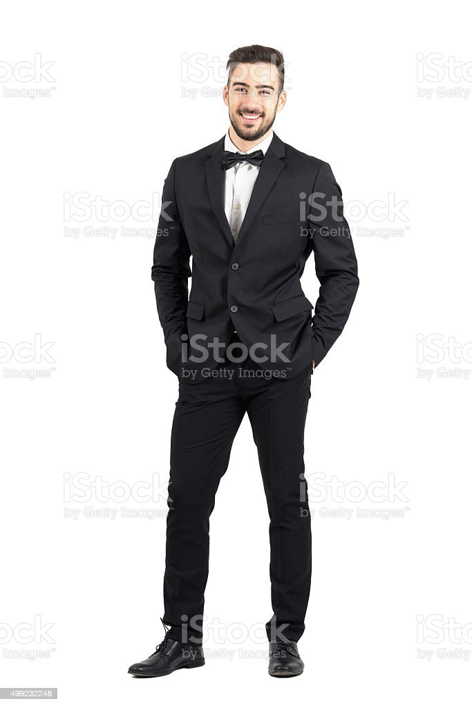 Laughing man in tuxedo with bow tie looking at camera stock photo