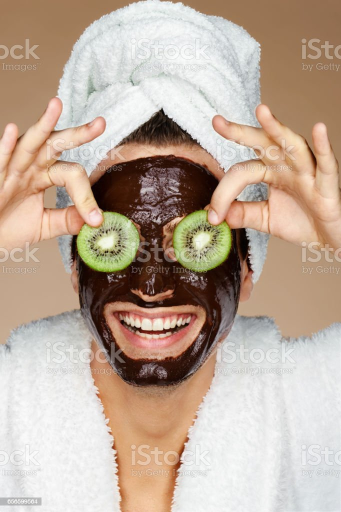Laughing man receiving spa treatments. stock photo