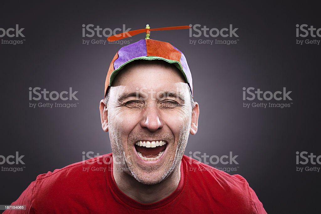 Laughing man wearing a propeller beanie stock photo
