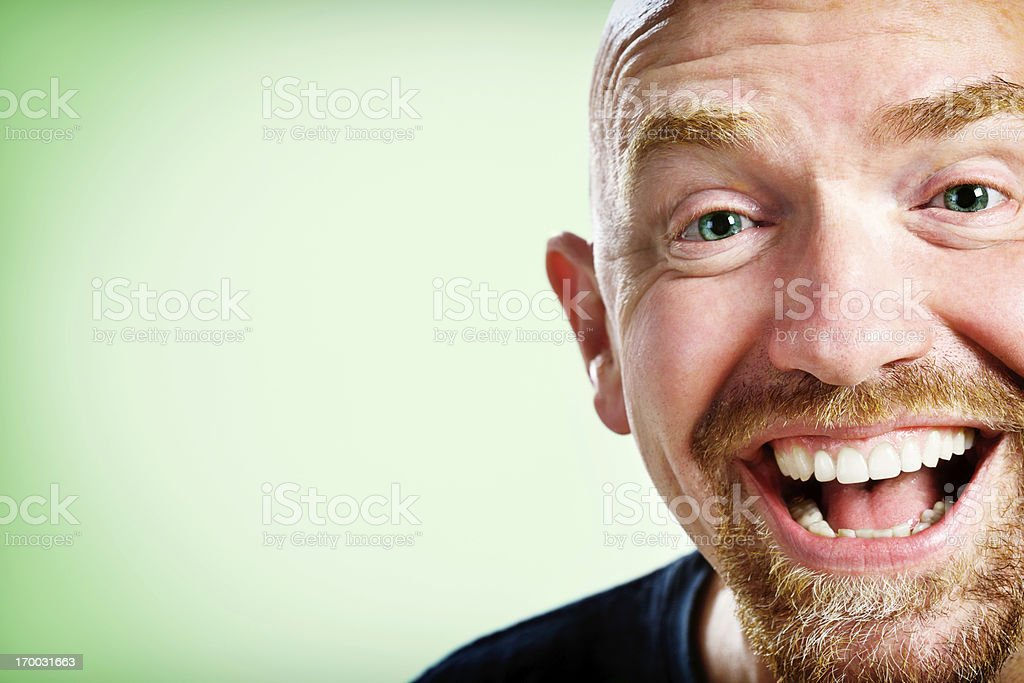 Laughing mature man sees the funny side of life stock photo