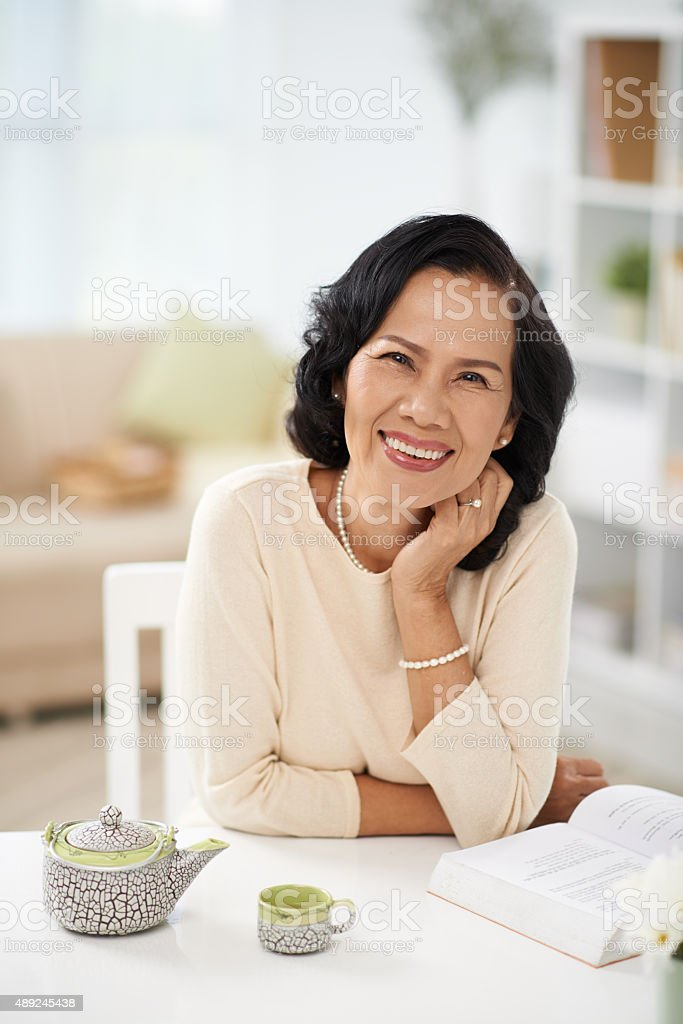 Laughing mature woman stock photo
