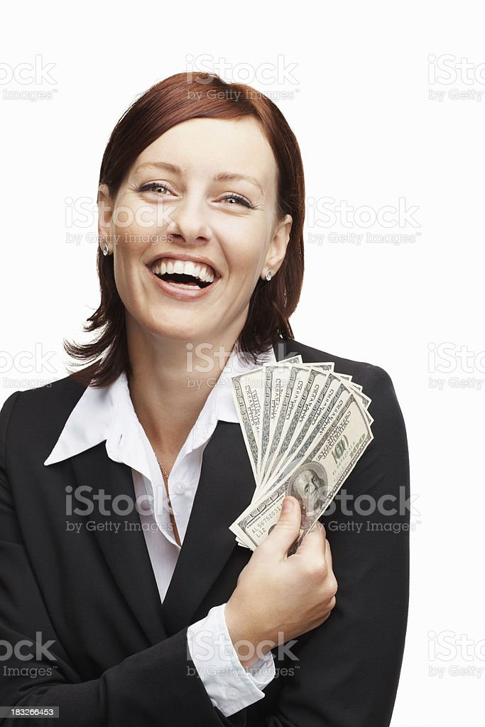 Laughing middle aged girl holding currency notes stock photo