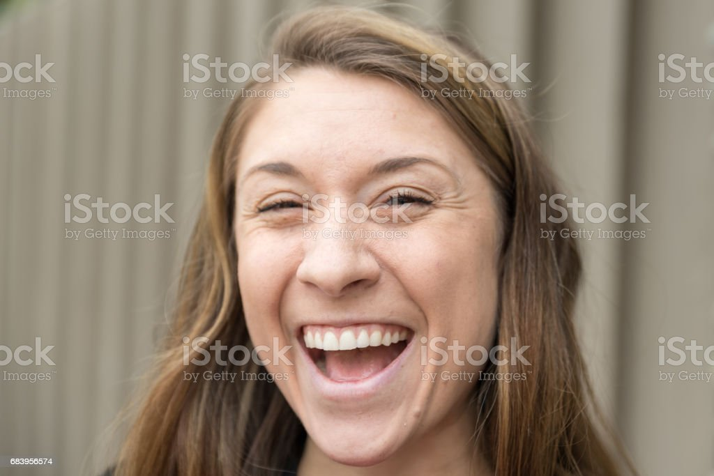Laughing  Millennial Women With Brown Hair Millennial Women With Brown Hair stock photo