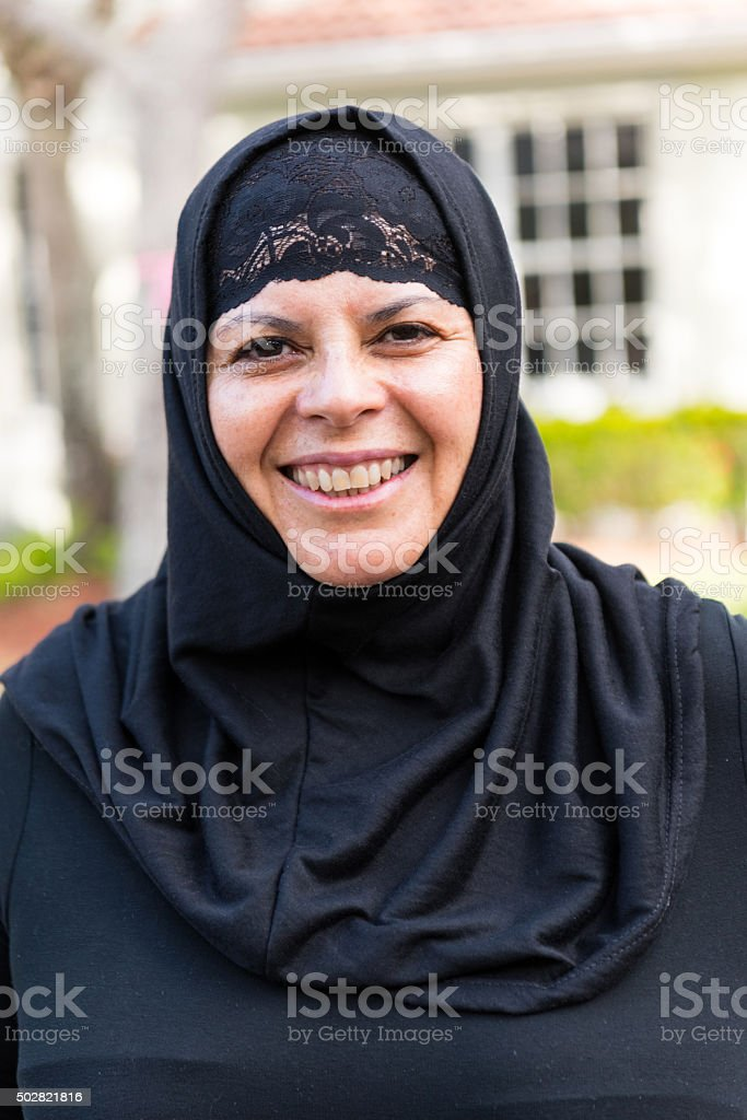 Laughing muslim woman stock photo