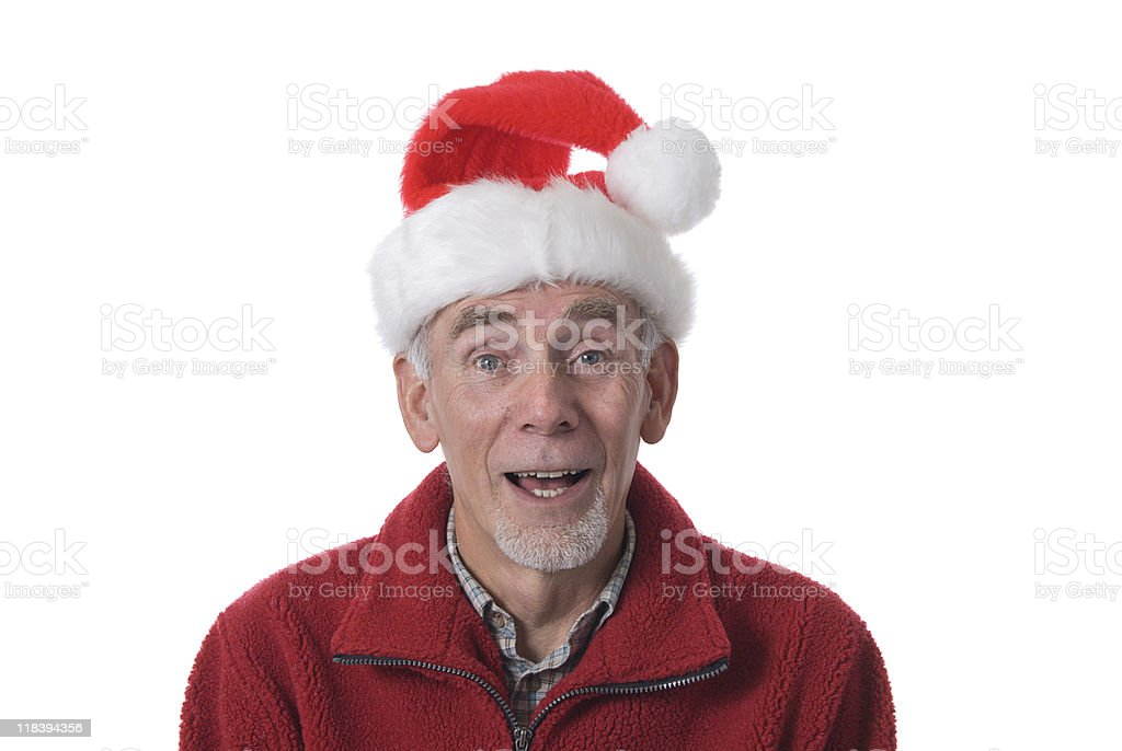 Laughing old man in Santa hat stock photo