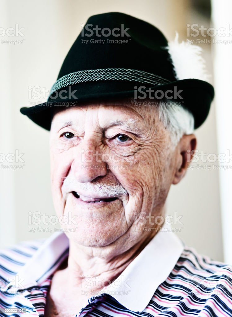 Laughing old man in smart Tyrolean hat stock photo