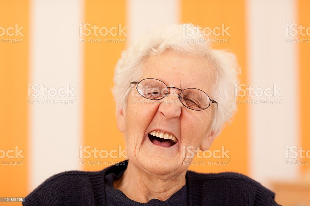 laughing old woman stock photo