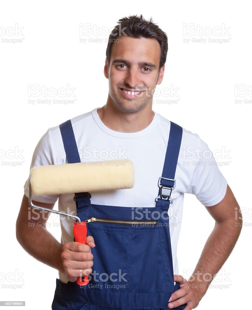 Laughing painter with painting roller stock photo