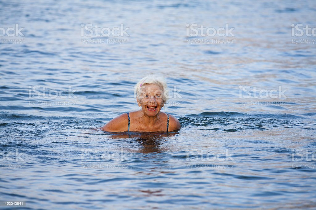 Laughing Senior Woman In The Sea royalty-free stock photo