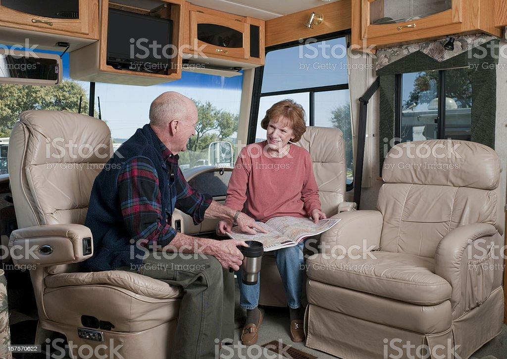 Laughing Seniors in Motorhome royalty-free stock photo