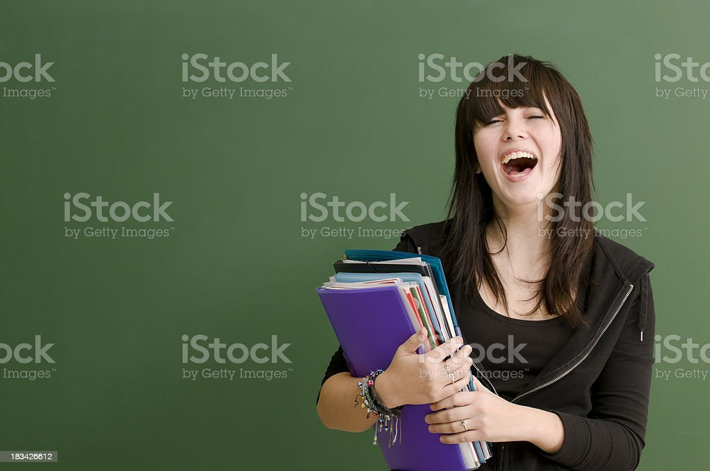laughing student at blackboard royalty-free stock photo