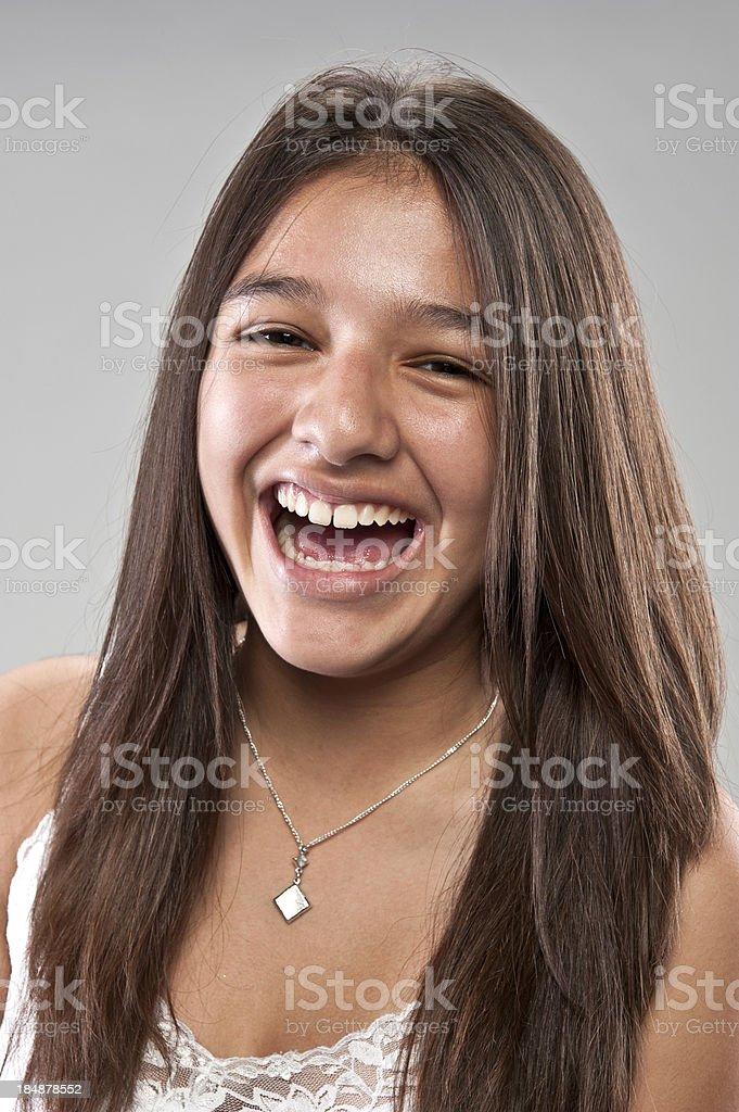 Laughing thirteen years old hispanic girl royalty-free stock photo