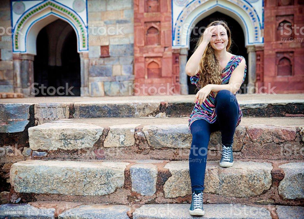Laughing tourist at Humayun Tomb. India stock photo