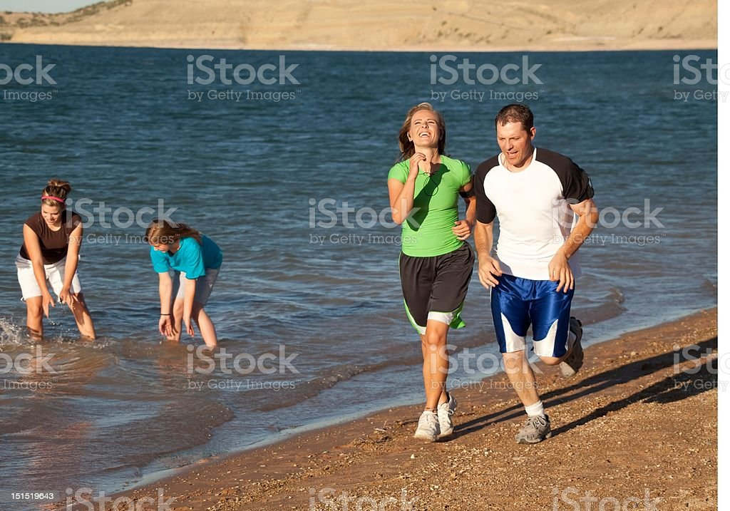 laughing while running couple royalty-free stock photo