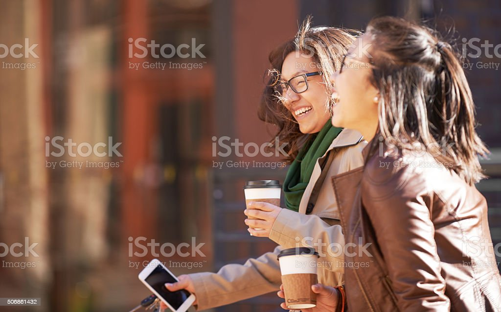 Laughing with your bestie until your stomach hurts stock photo