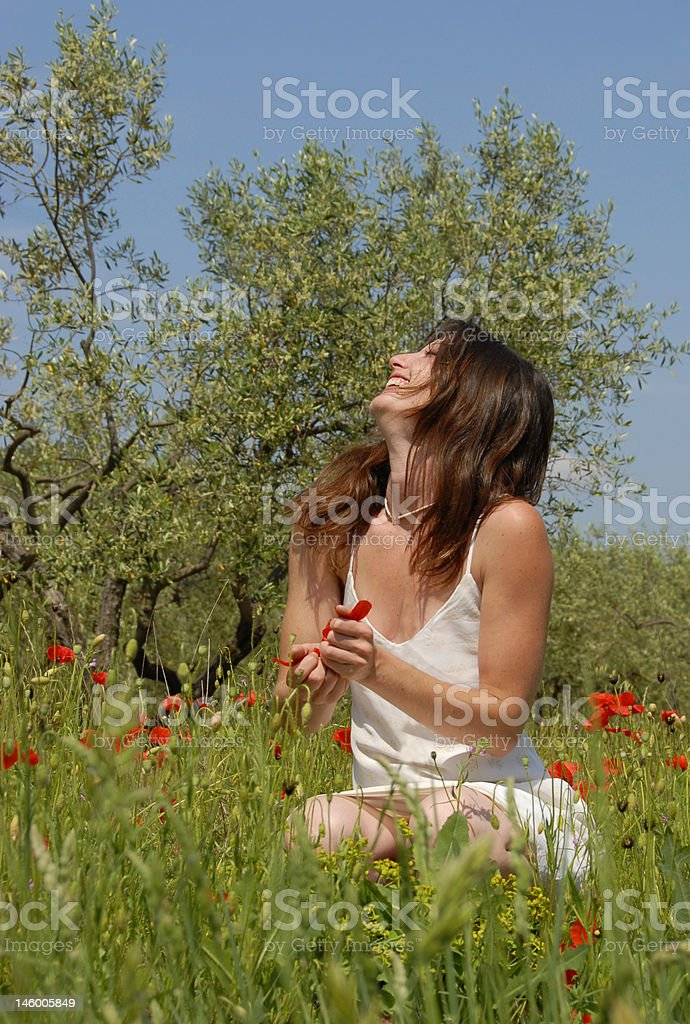 laughing woman in field royalty-free stock photo