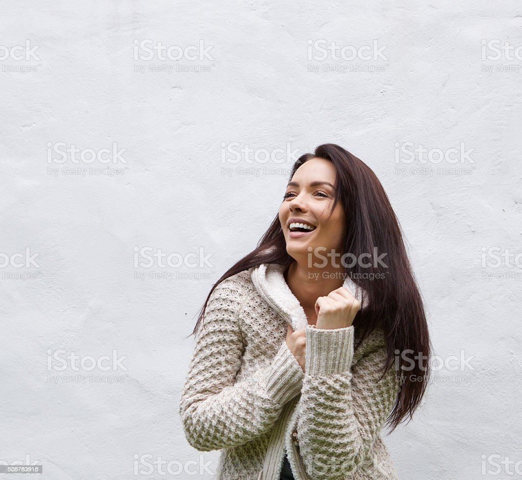 Laughing woman in knitted wool sweater stock photo