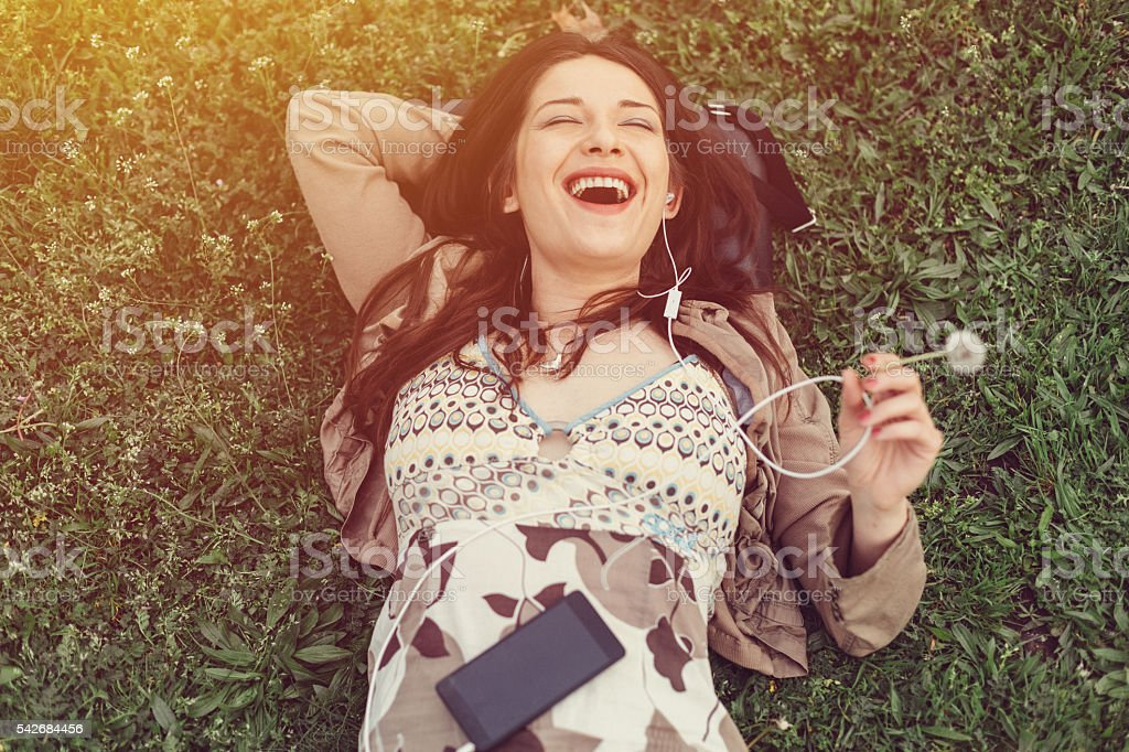 Laughing woman resting in the park stock photo