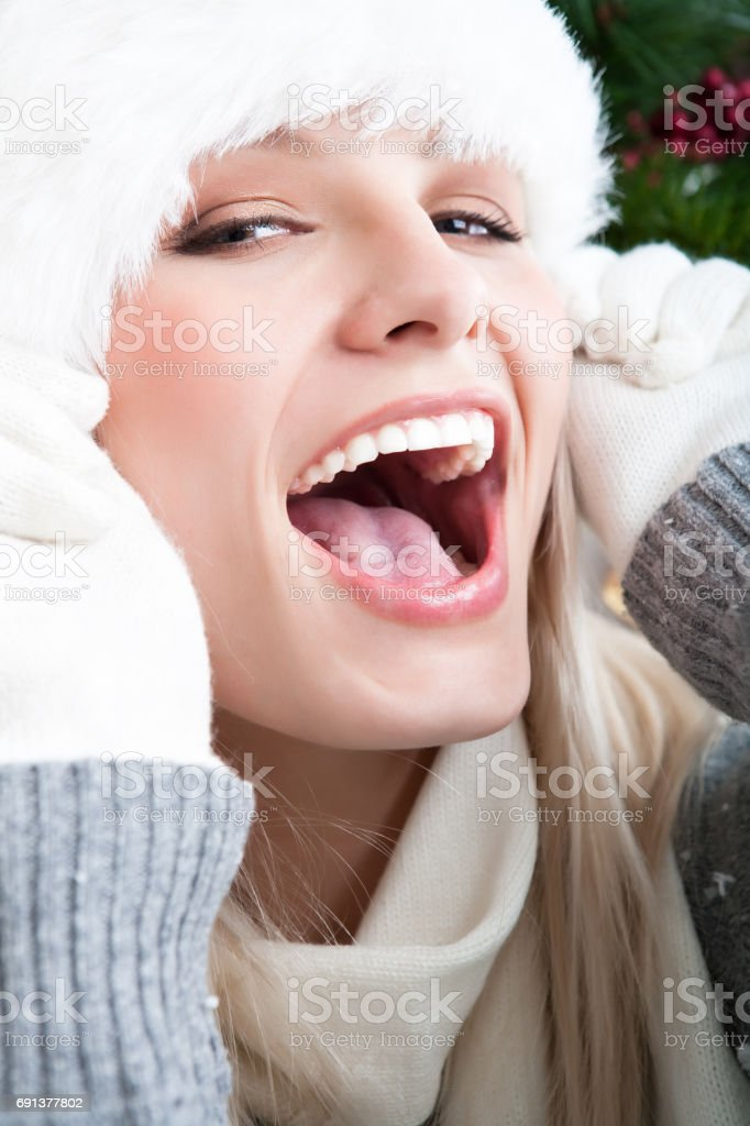 Laughing woman wearing santa hat stock photo