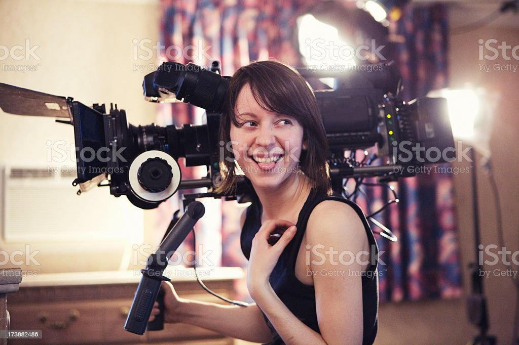 Laughing Woman with Camera royalty-free stock photo