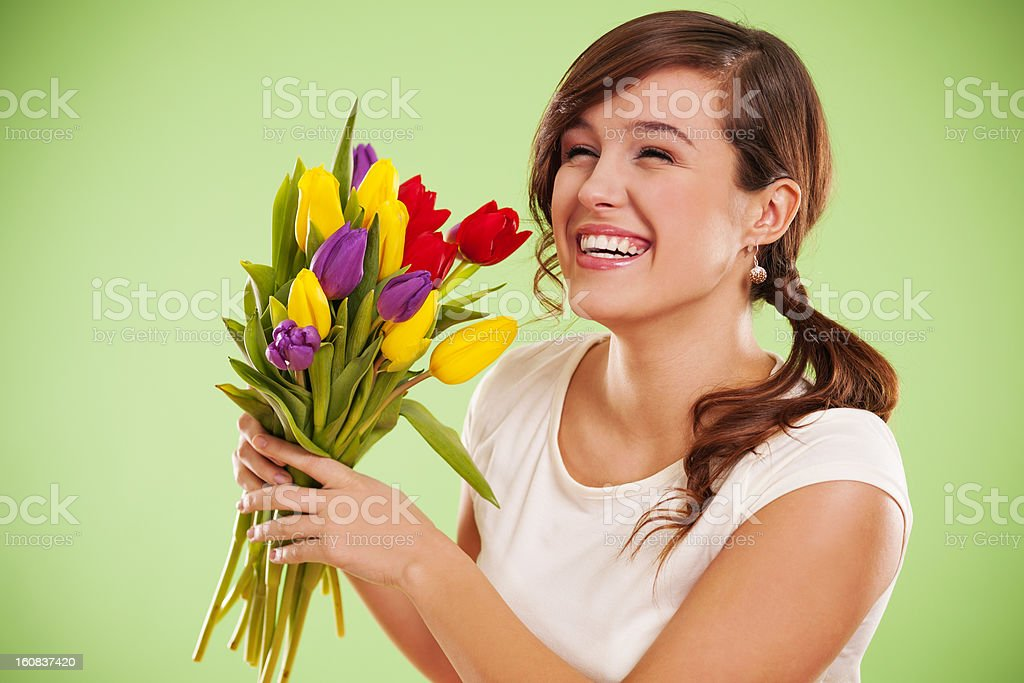 Laughing woman with tulips royalty-free stock photo