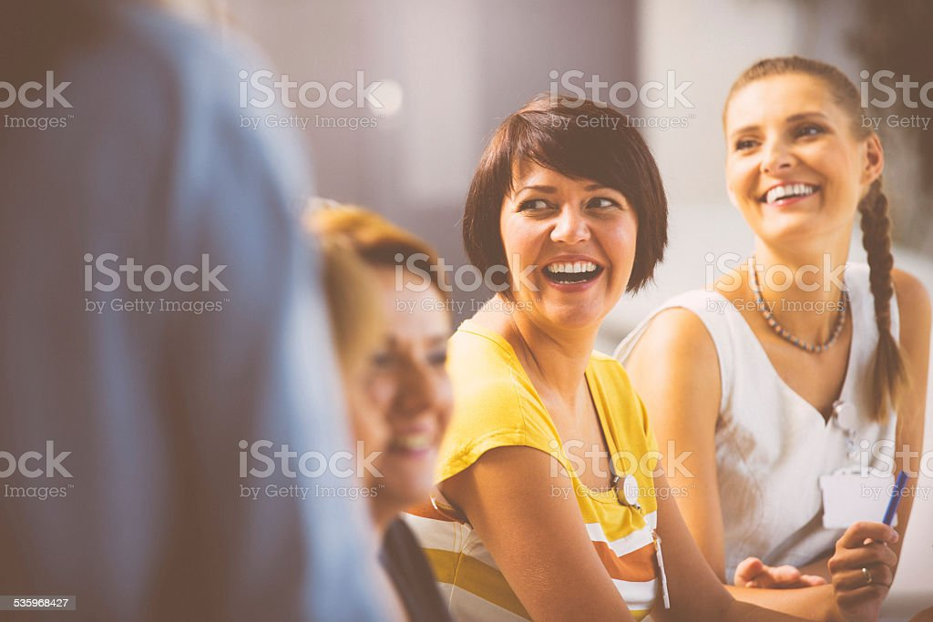 Laughing women on seminar stock photo