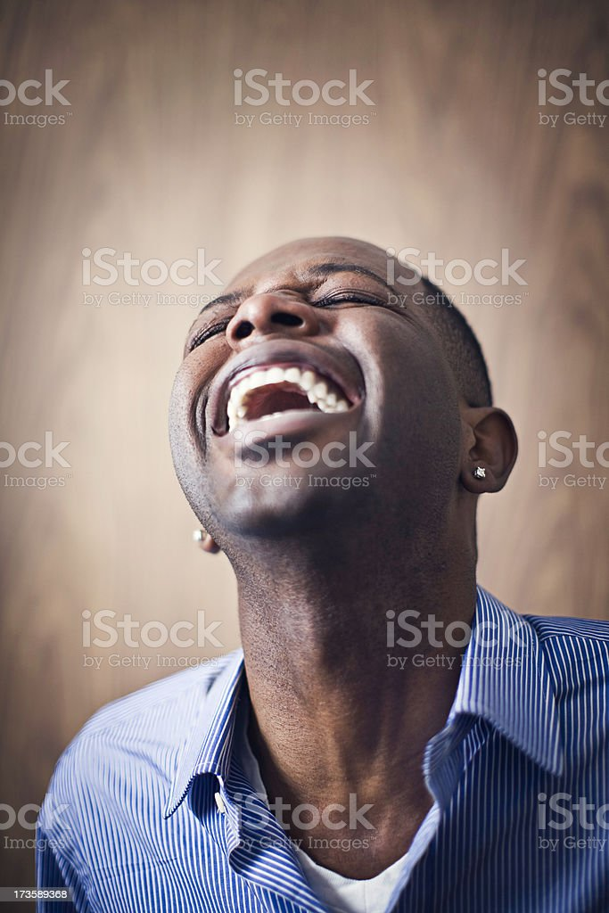 Laughing Young African American Man stock photo