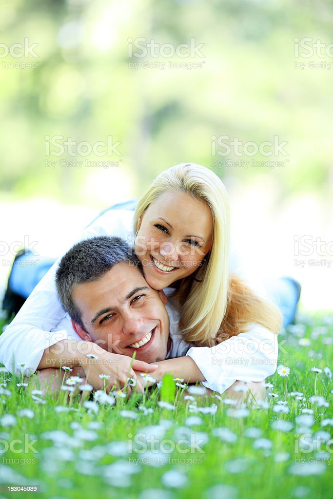 Laughing young couple enjoying the spring. royalty-free stock photo