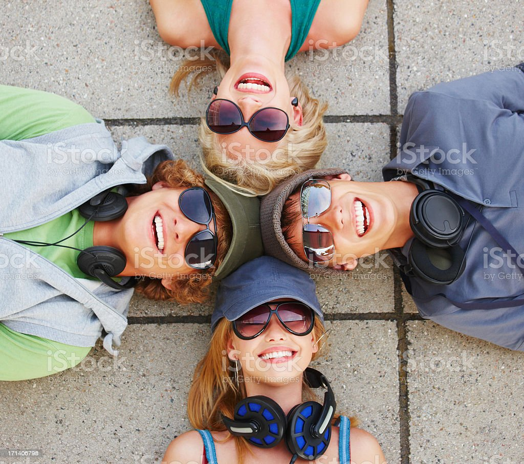 Laughing young friends from above royalty-free stock photo