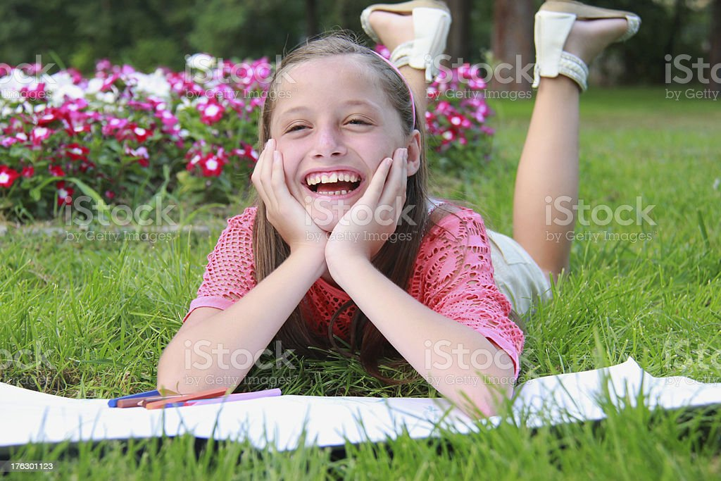 laughing young girl in the park royalty-free stock photo