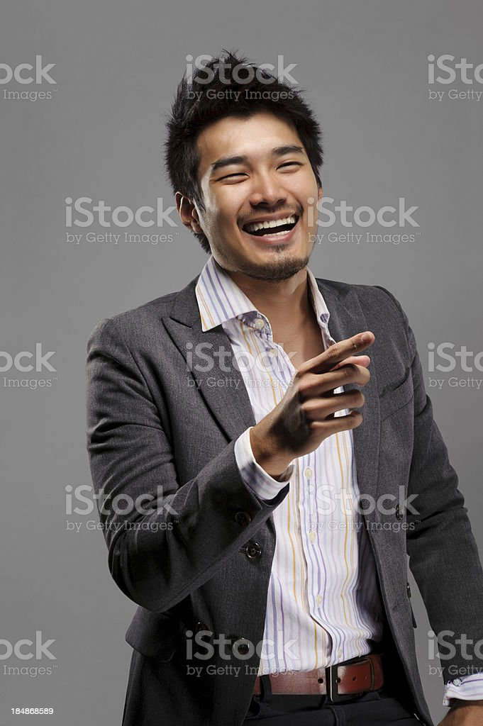 Laughing young guy stock photo