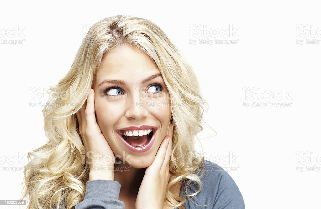 Laughing young woman against white background royalty-free stock photo