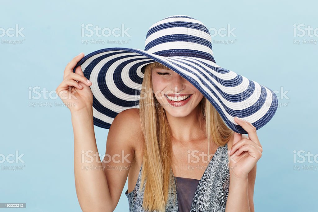Laughing young woman in sun hat stock photo