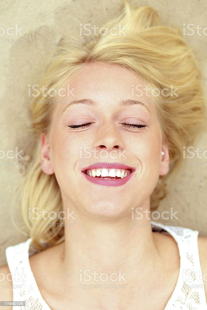 laughing young woman on the beach royalty-free stock photo