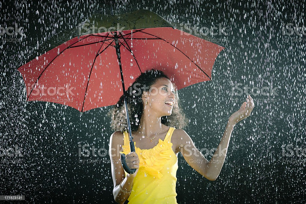 Laughing Young woman with umbrella enjoying rain royalty-free stock photo