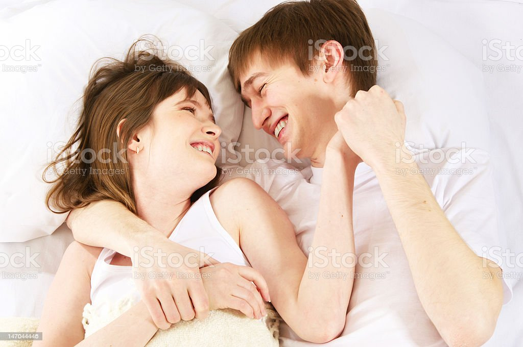 laughter in bed royalty-free stock photo