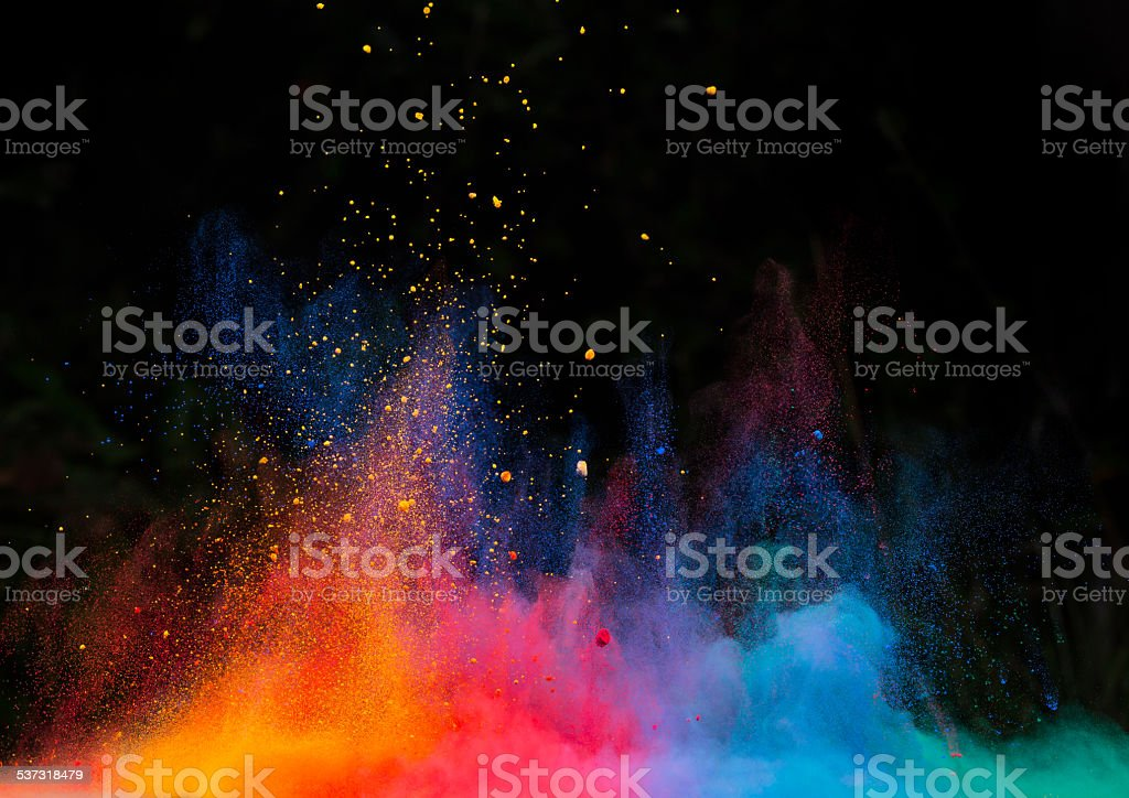 launched colorful powder over black stock photo