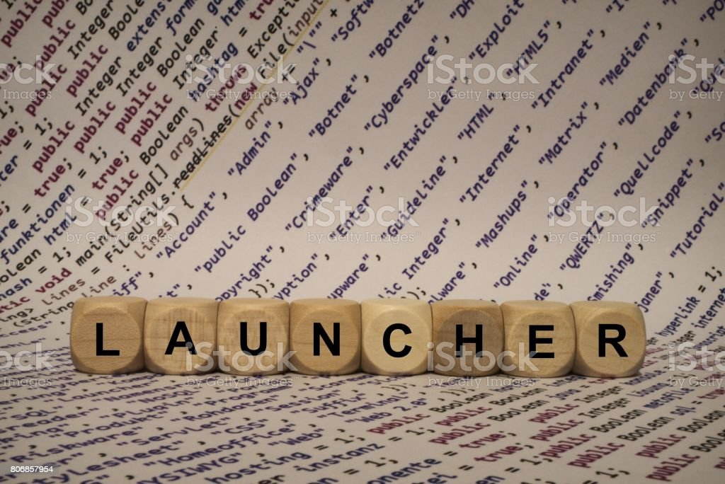launcher - cube with letters and words from the computer, software, internet categories, wooden cubes stock photo